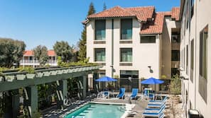Outdoor pool, open 10:00 AM to 10:00 PM, pool umbrellas, sun loungers
