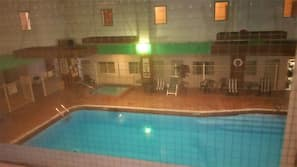 Indoor pool, open 9:30 AM to 10:00 PM, pool umbrellas, sun loungers