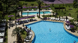 2 outdoor pools, open 10:00 AM to 7:00 PM, pool umbrellas, sun loungers