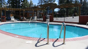 Outdoor pool, open 10 AM to 10 PM, pool umbrellas