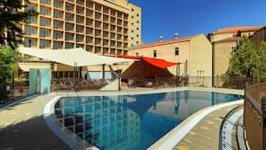 Seasonal outdoor pool, open 6 AM to 10 PM, pool umbrellas, sun loungers