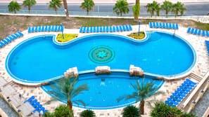 Seasonal outdoor pool, open 8 AM to 5 PM, pool umbrellas, sun loungers