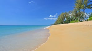 Private beach, white sand, sun-loungers, windsurfing