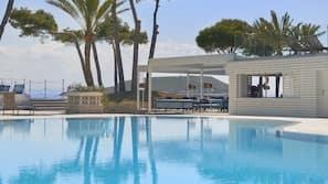 Indoor pool, 2 outdoor pools, open 10 AM to 6 PM, pool umbrellas