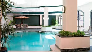 Indoor pool, open 6:00 AM to 10:00 PM, pool loungers