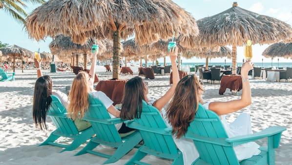 2 bars/lounges, poolside bar, beach bar