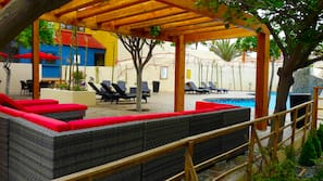 Outdoor pool, open 10 AM to 10 PM, pool umbrellas, sun loungers