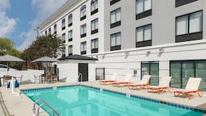 Seasonal outdoor pool, open 7:00 AM to 11:00 PM, pool umbrellas