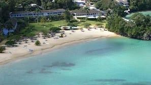 White sand, beach towels, kayaking, rowing