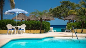 Outdoor pool, open 8:00 AM to 10:00 PM, pool umbrellas, sun loungers