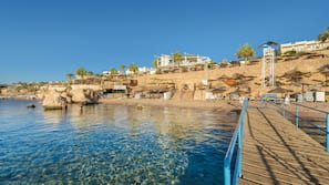 Spiaggia privata, teli da spiaggia, massaggi sulla spiaggia