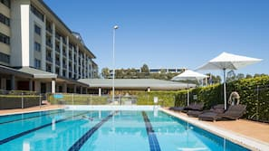 Outdoor pool, open 6:00 AM to 9:30 PM, sun loungers