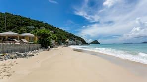 On the beach, sun loungers, beach towels, beach bar