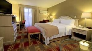 Minibar, caja fuerte, tabla de planchar con plancha y camas supletorias