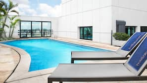 Outdoor pool, open 8:00 AM to 5:00 PM, pool loungers