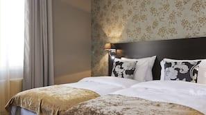 Ropa de cama de alta calidad, minibar, escritorio