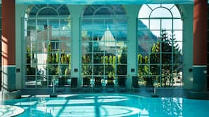 2 indoor pools, 2 outdoor pools, open 9:00 AM to 8:00 PM, pool loungers