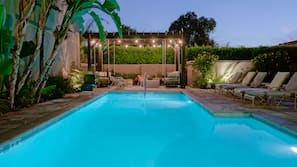 Outdoor pool, open 7:00 AM to 10:00 AM, pool umbrellas, pool loungers