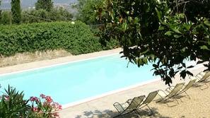 Seasonal outdoor pool, open 8:30 AM to 7:30 PM, pool umbrellas