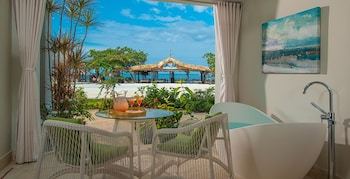 Beachfront Honeymoon Walkout Club Level Junior Suite w/ Tranquility Soaking Tub - Guestroom View