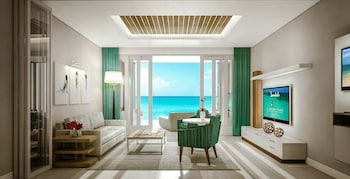 Beachfront Millionaire One-Bedroom Butler Suite w/ Tranquility Soaking Tub - Living Area