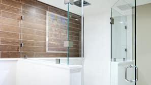 Separate tub and shower, designer toiletries, hair dryer, bathrobes
