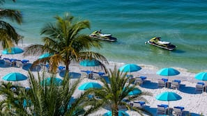 On the beach, white sand, beach towels, kayaking