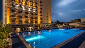 Seasonal outdoor pool, open 7:00 AM to 10:00 PM, pool umbrellas