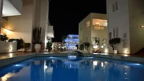 Indoor pool, 4 outdoor pools, open 9 AM to 8 PM, pool umbrellas