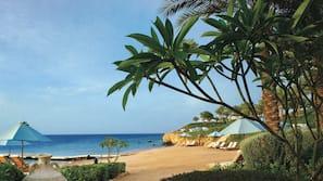 On the beach, white sand, free beach shuttle, free beach cabanas
