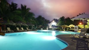 2 outdoor pools, open 9:00 AM to 9:00 PM, pool umbrellas