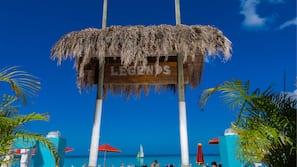 On the beach, white sand, free beach shuttle, sun loungers