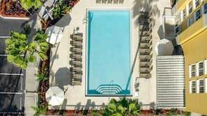 Outdoor pool, open 8 AM to 11 PM, pool umbrellas, sun loungers