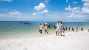 On the beach, white sand, beach shuttle, sun loungers