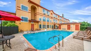 Seasonal outdoor pool, open 9 AM to 10 PM, pool umbrellas