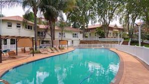Seasonal outdoor pool, open 4:00 AM to 10:00 PM, pool umbrellas