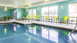 Indoor pool, open 6 AM to 11 PM, pool umbrellas, sun loungers