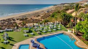 Outdoor pool, a lap pool, pool umbrellas, pool loungers