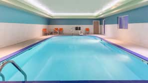 Indoor pool, open 8 AM to 11 PM, pool umbrellas, pool loungers