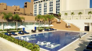 2 outdoor pools, open 9:00 AM to 7:30 PM, pool umbrellas
