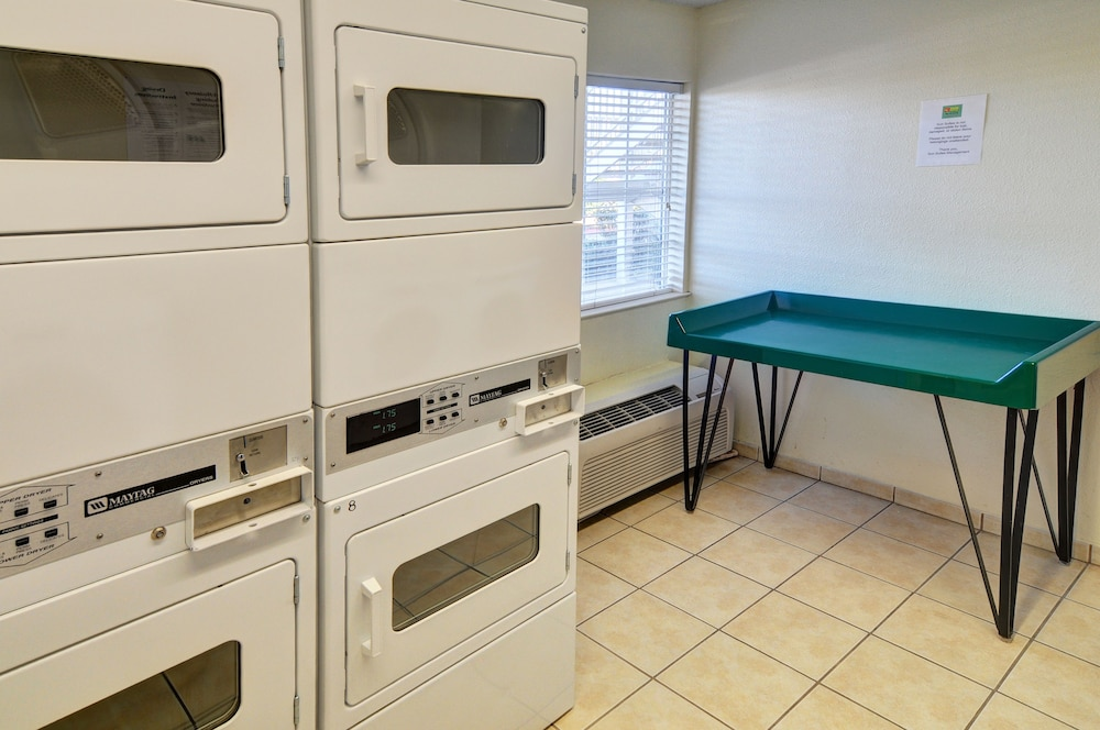 Laundry Room, InTown Suites Extended Stay Lewisville TX East Corporate Drive