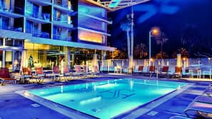 Outdoor pool, open 7:00 AM to 11:00 AM, pool umbrellas, pool loungers