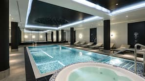 Indoor pool, pool loungers, lifeguards on site