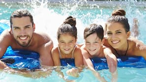 Outdoor pool, open 8:00 AM to 9:00 PM, pool umbrellas