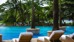 Outdoor pool, open 6:00 AM to 11:00 PM, pool umbrellas, pool loungers