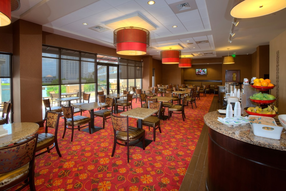 Restaurant, Ramada Plaza Resort & Suites by Wyndham Orlando Intl Drive