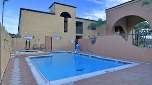 Outdoor pool, open 9 AM to 10:00 PM, pool umbrellas