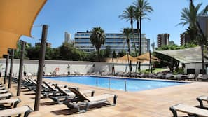 Outdoor pool, pool loungers, lifeguards on site