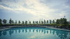 Outdoor pool, open 8:00 AM to 7:00 PM, pool umbrellas, pool loungers