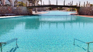 Indoor pool, outdoor pool, open 10:00 AM to 6:30 PM, pool umbrellas